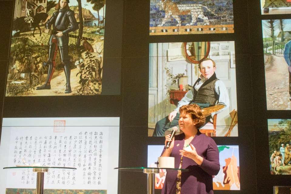 Photo of Kate Fernie speaking in front of the display wall at the Google Culture Institute